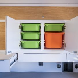 Storage bins accessible from both the galley and the interior.