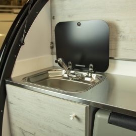 Sink located at the back of the trailer.