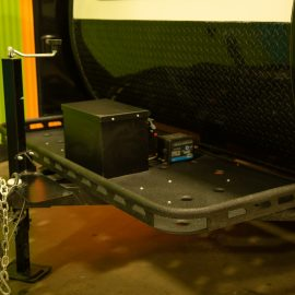 All of our teardrop trailers come with a front storage bin. This is where your electrical power is housed.