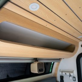 Overhead cubby with front window option.